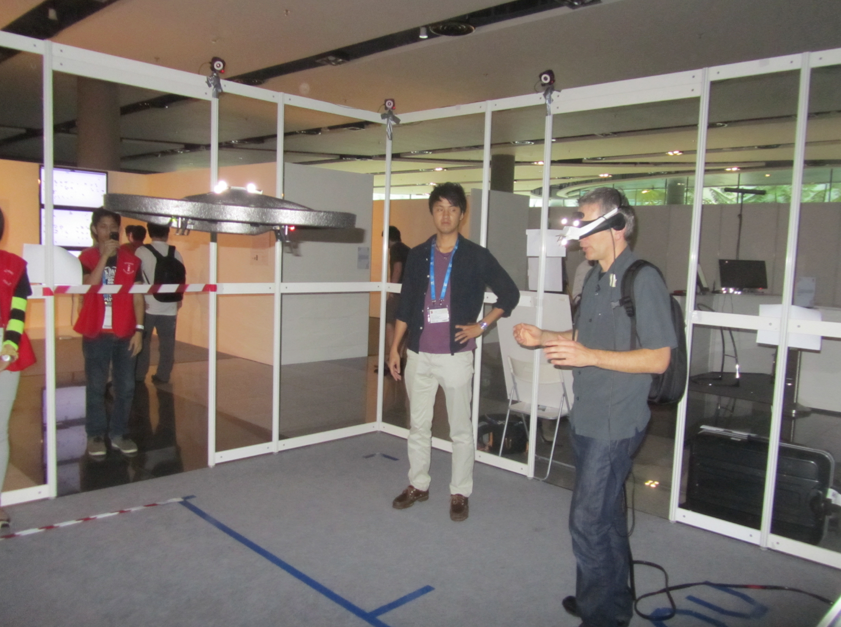 steer a quadcopter with your body movement, with HMD, by Keita Higuchi (The University of Tokyo) and Jun Rekimoto (The University of Tokyo)