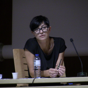 Nina Wenhart hosting the panel discussion